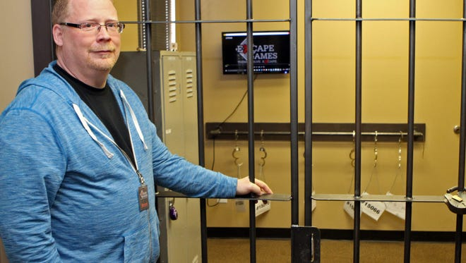 Brent Streeter and his wife Joyce have just opened Excape Games, an interactive experience that will challenge Clarksville's best and brightest. He is standing in the room known as Jailbreak, from which teams have about a 40% success rate of escape.