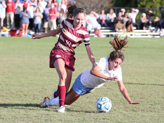 USJ's Nour Nabhan takes a hit from an ECS player on Friday in the D2-A semifinals.