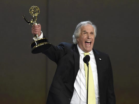 """Henry Winkler accepts the award for outstanding supporting actor in a comedy series for """"Barry"""" at the 70th Primetime Emmy Awards on Monday, Sept. 17, 2018, at the Microsoft Theater in Los Angeles."""