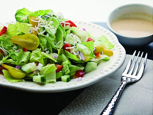 Loaded chopped salad with chipotle-hummus dressing