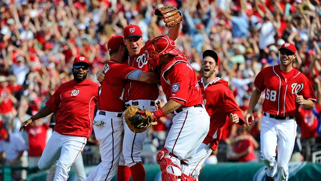 Jordan Zimmermann (center) is congratulated by catcher Wilson Ramos (right) and Kevin Frandsen (19) after recording the final out of a no-hitter.