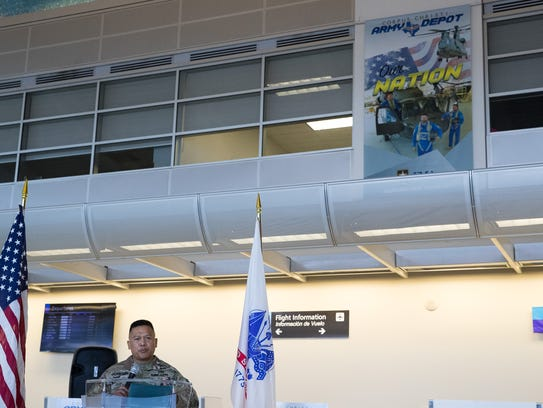 Col. Allan Lanceta, Commander of the Corpus Christi Army Depot, speaks at the Corpus Christi International Airport. Three banners were unveiled Thursday to honor the depot and its personnel.
