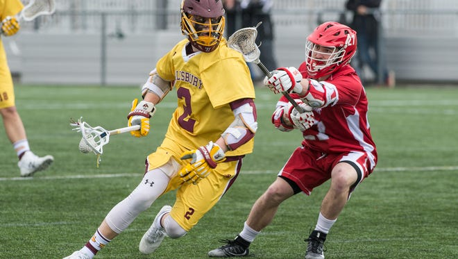 Salisbury University's Griffin Moroney (2) maneuvers the ball during a game against Lynchburg College on Saturday, Feb. 10, 2018.