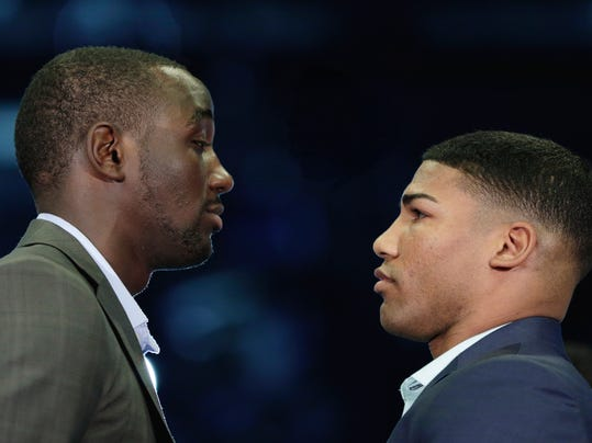 Terence Crawford, left, and Yuriorkis Gamboa pose for a photo at a news conference in Omaha, Neb., Thursday, May 8, 2014,  to announce their world lightweight championship fight in June. Crawford will defend his WBO title in his hometown, in the first world championship fight in Omaha since Joe Frazier stopped Ron Stander in 1972. (AP Photo/Nati Harnik)