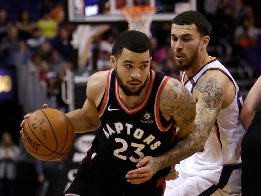 Toronto Raptors guard Fred VanVleet (23) drives past Phoenix Suns guard Mike James in the second quarter during an NBA basketball game, Wednesday, Dec 13, 2017, in Phoenix. (AP Photo/Rick Scuteri)