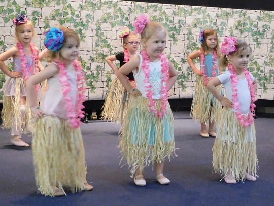 Hula tells a story through body and hand motions.