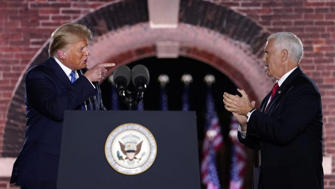 Vice President Mike Pence, pictured at the Republican National Convention on Aug. 26 with President Donald Trump, will visit Zanesville, Ohio on Wednesday.