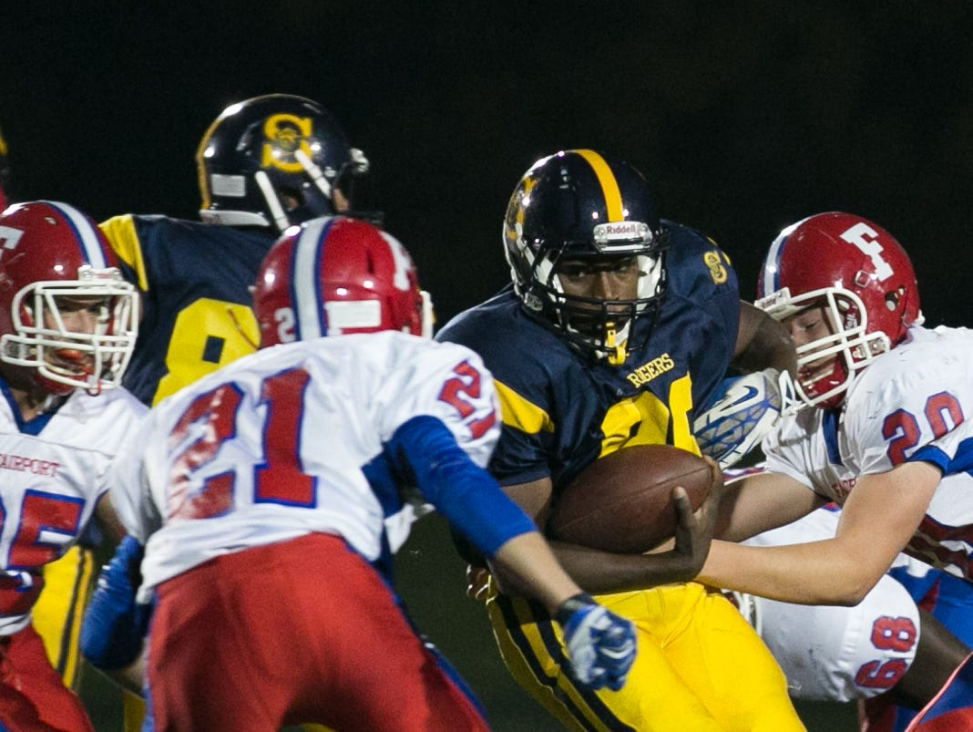 Spencerport's Tahj Snow carries the ball against Fairport.