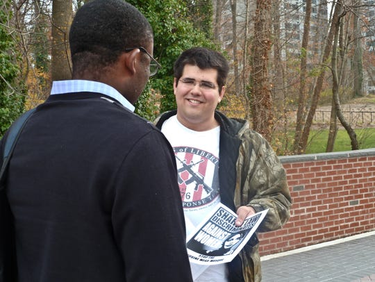 Matthew Heimbach in 2012 handing out leaflets against