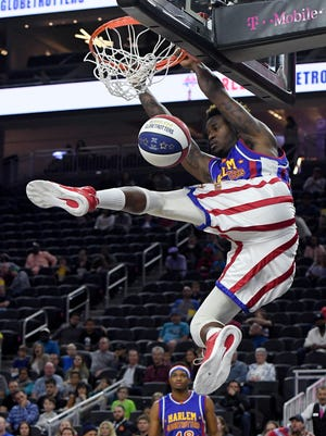 """Angelo """"Spider"""" Sharpless of the Harlem Globetrotters dunks the ball during an exhibition against the World All-Stars on Feb. 9, 2017, at T-Mobile Arena in Las Vegas."""