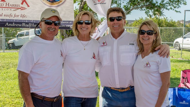 "Scott and Martha Harris, left, and Bruce and Sarah Boyd, attend Jupiter Seafood Festival, whose benefiting charity was The Andrew ""Red"" Harris Foundation, in honor of the Harris' late son."