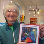 Lois Duffy displays the Silver City Art Association's 2015-16 Red Dot Art Guide. The 2016-17 Red Dot Art Guide will be published in July.