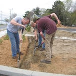 Horticulture students at Indian River High School spent about six hours implementing a provided site plan and developing the perimeter of the day care center that runs alongside West State Street.
