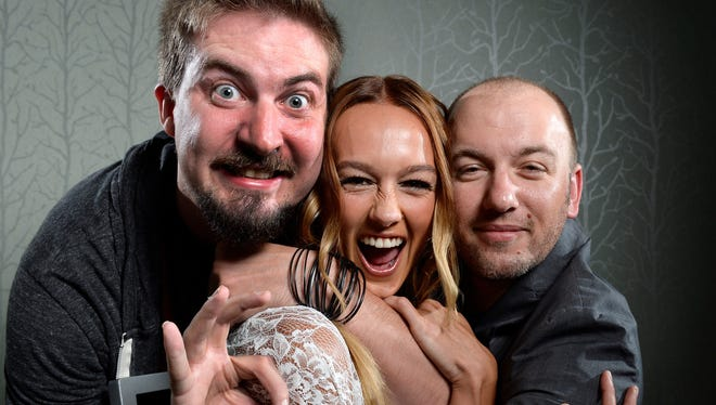 Director Adam Wingard (left) and writer  Simon Barrett (right) found the actress they were looking for Sharni Vinson (center) for their new horror-thriller 'You're Next.'