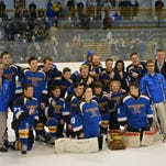 The Maine-Endwell hockey team poses for a photo after winning the championship on Saturday night at SUNY Broome.