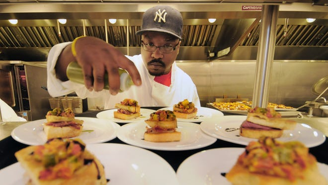A World Cafe Live at the Queen chef puts the finishing touches on grilled cheese dishes. More food and beverage events are headed to the Wilmington venue.