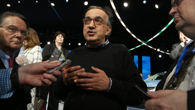 Sergio Marchionne, CEO of Fiat Chrysler Automobiles, talks with members of the media after his meeting with National Highway Traffic Safety Administration Administrator Mark R. Rosekind at the FCA stage at the 2016 North American International Auto Show.