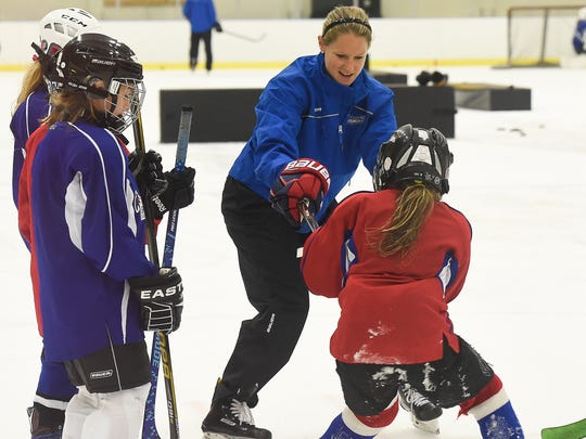 Kacey Bellamy of the Women's USA Olympic hockey team coaches young girls from Breakaway hockey camp at Centennial Sportsplex on July 22, 2017, in Nashville.