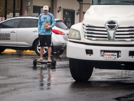 Austin Dale, of Fort Pierce, rides his hoverboard Monday,