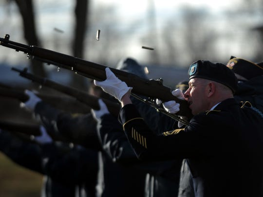Jason Leasher fires a rifle with members of the Ross County Veterans Honor Guard Tuesday, Jan. 30, 2018, during the funeral services for Mark Elkins at Greenlawn Cemetery in Chillicothe.