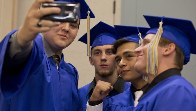 Bryan Schneider takes a selfie with Brady Wood, Oscar Leon and Nick La Valle before the Reed High School graduation at Lawlor Events Center on Saturday, June 14, 2014.