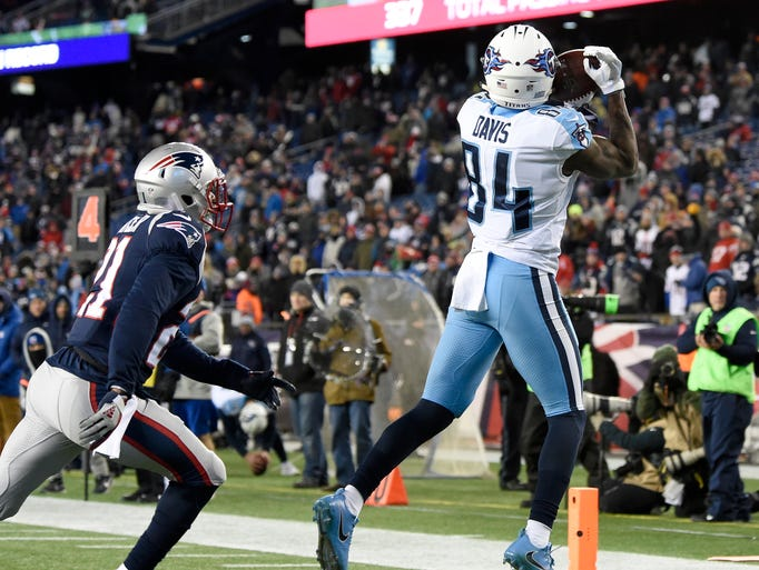 Titans wide receiver Corey Davis (84) goes up for a
