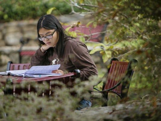 Jasmine Woo studying academics
