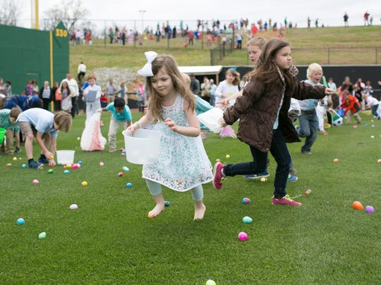 Kids participate in an Easter Egg hunt at the Ballpark at Jackson in 2015.