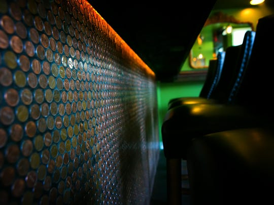Thousands of pennies adorn the bar at Copperhead Saloon in Greenville.