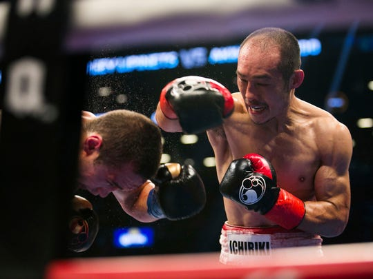 Sergey Lipinets, left, tries to avoid a punch from Akihiro Kondo during the IBF super lightweight title boxing bout Saturday, Nov. 4, 2017, in New York, New York. Lipinets won the bout. (AP Photo/Kevin Hagen)