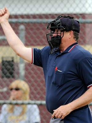 Umpire Mike O'Roark calls a strike while working a softball game at Arlington High School in Freedom Plains between Arlington and John Jay on Friday.