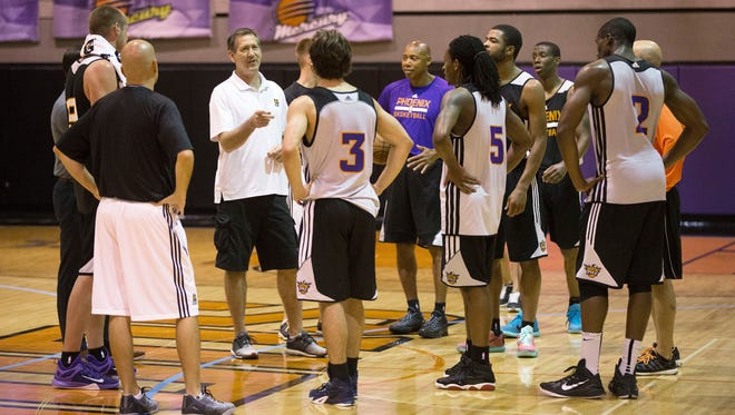 Suns coach Jeff Hornacek talks with the players at the Phoenix Suns draft workout on Wednesday, May 27, 2015, at US Airways Center in Phoenix.