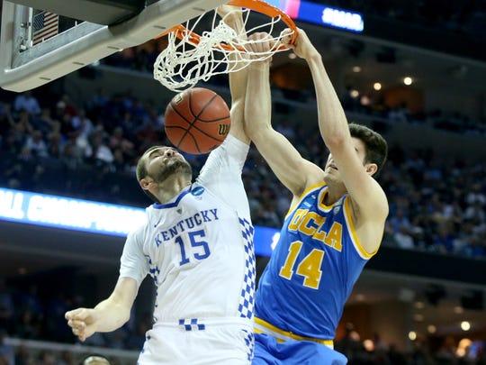 UCLA's Gyorgy Goloman dunks on Kentucky's Isaac Humphries