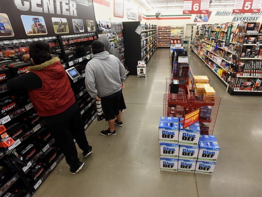 Customers shop for batteries at the O'Reilly Auto Parts location on North Butler Avenue in Farmington on Saturday.