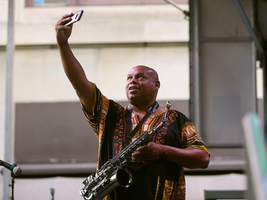 Jimmie Highsmith Jr. of Rochester, takes a selfie while