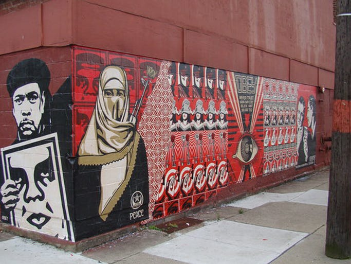 The Shepard Fairey mural at at the former Spectrum Nightclub at 5020 Whetsel Ave. in Madisonville before is was painted over.