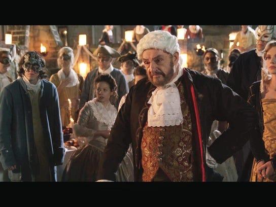 John Rhys-Davies plays Charles Kemp of the British