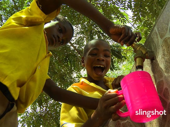 "Boys fetch water in ""SlingShot,"" a documentary about"