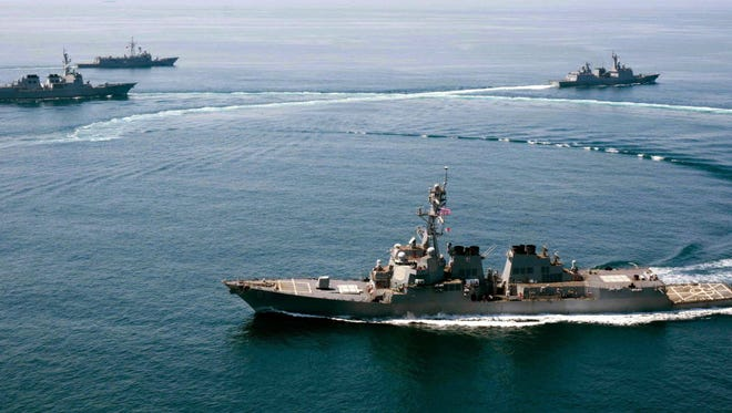 A handout photo released by the U.S. Navy dated May 25, 2015, shows the guided-missile destroyer USS Lassen  conducting an exercise in with Turkish and South Korean Navy.