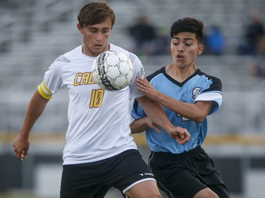 Marcos Vila, a senior foreign exchange student at Iowa Falls-Alden, left, battles South Tama's Adrian Nunez for the ball during their game on Wednesday, May 24, 2017, in Iowa Falls. Vila has helped lead to Cadets boys soccer program to an undefeated season so far this year.