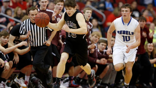Maple Valley-Anthon-Oto guard Austin Hazard (left) dribbles down the court for the Rams in the 2015 Class 1A state championship game. MVAO is 18-2 this season and unranked heading into the 1A playoffs.