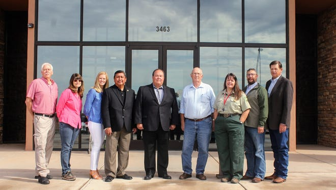 Forest Service partners stand in front of the Lincoln National Forest Service headquarters Wednesday after they signed the monumental Southern Sacramento Mountain Watershed and Forest Restoration Strategy that focuses on restoring the county's watersheds.