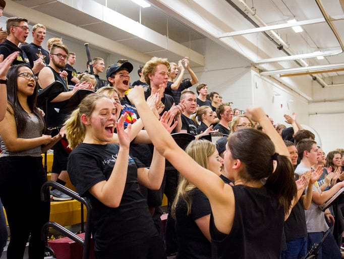 Members of the Windsor band celebrate a score against