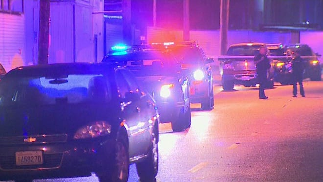 Two people were killed and three were hurt in a shooting at a homeless encampment south of downtown Seattle.