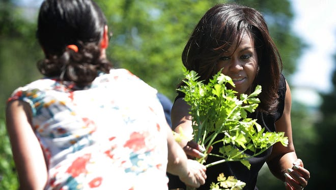 First lady Michelle Obama harvests the White House Kitchen Garden earlier this year. She did so again last week, for the final time, with some DeSoto County students and teachers.