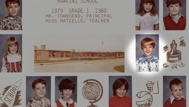 Dressed in a white and blue shirt, Shawn Moore, who was kidnapped and murdered in 1985, is pictured in this first-grade class photo from Hawkins Elementary School.