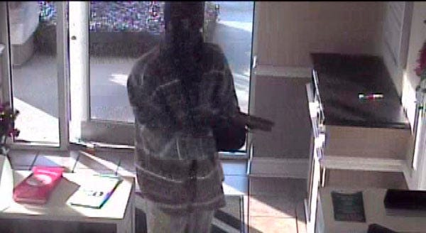 Security camera photo of one suspect who robbed a BankcorpSouth branch in Tupelo, Miss., on Dec. 23, 2013.