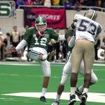 MSU punter Craig Jarrett in action against Purdue in 2000.