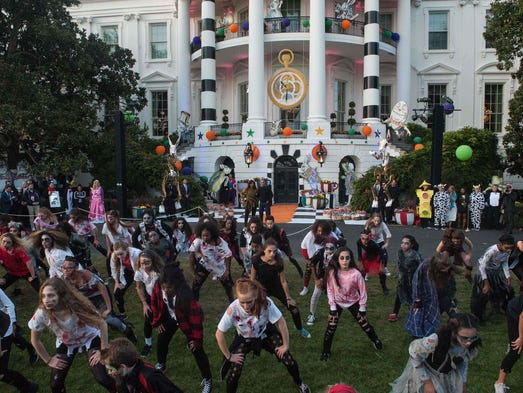 Obamas dance to 'Thriller' at White House Halloween party