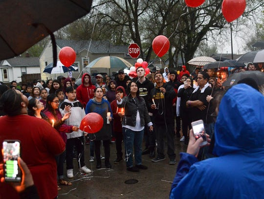 Mourners released balloons Wednesday in honor of 20-year-old